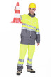 Traffic guard holding a pylon