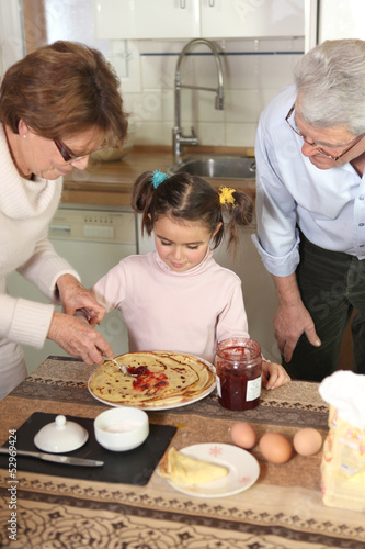 Family preparing pancakes