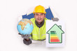 Tradesman holding a globe and an energy efficiency rating chart