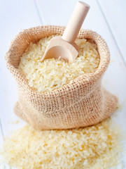 Raw rice on the table, portion of the raw rice