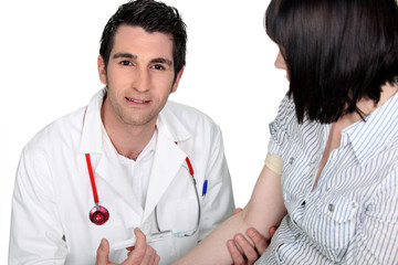 Doctor injecting patient