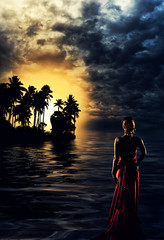 Blonde woman in red dress at sunset