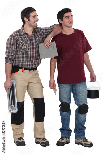 Two men about to plaster