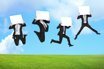 Business man jumping with billboard