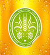 Beer label on beer background with drops