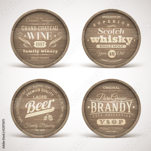 Set of wooden casks with alcohol drinks emblems