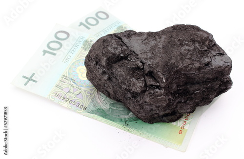 Large coal lump with money on white background - 52971853