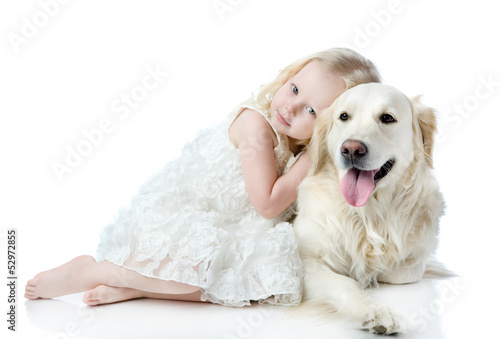 girl embraces a Golden Retriever. looking at camera. isolated