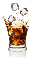 Cola in glass with falling ice cubes on white. With clipping pat