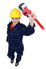 Female worker with an adjustable pipe wrench