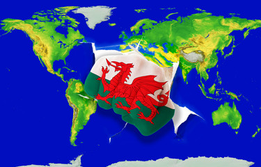 Fist in color  national flag of wales    punching world map