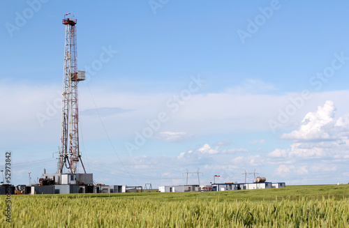 field with oil drilling rig