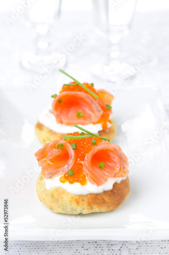 potato bun with salted salmon, red caviar and chives