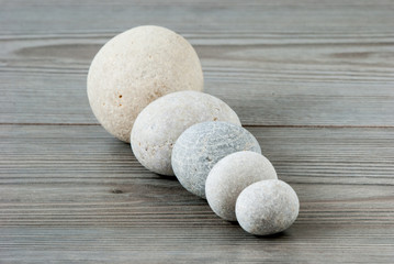Five river stones on a table