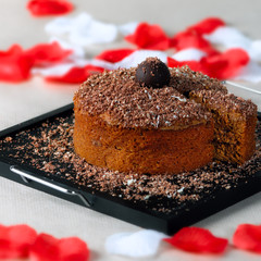 Romantic chocolate walnut cake with slice on the side