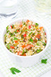 bowl of salad with bulgur, zucchini, tomatoes and parsley