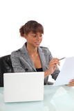 Smiling businesswoman reading a document