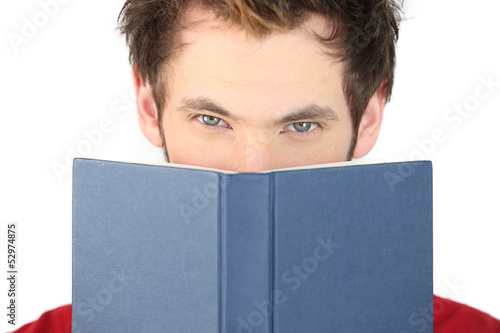 Man covering his face with the bible