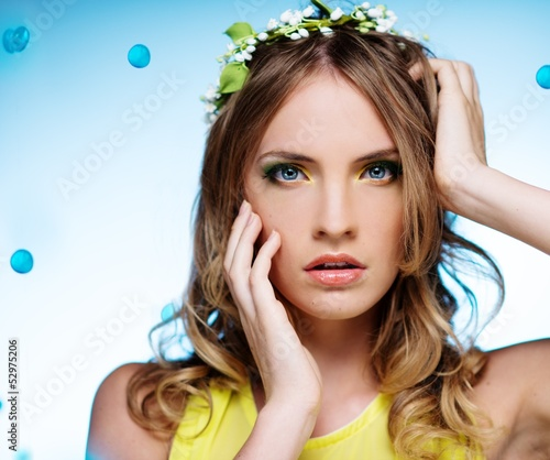 Portrait of a young beautiful girl wearing may-lily chaplet