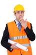 construction businessman putting a hand on his mouth
