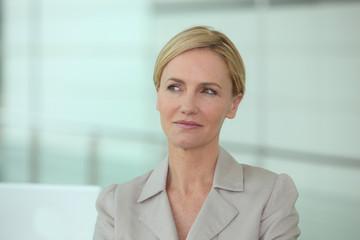 Blond woman thinking