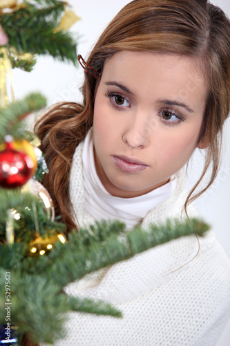 Young woman looking at Christmas ornaments