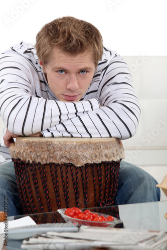 Man with his arms on his drum