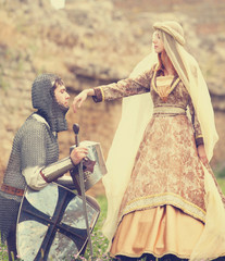 Knight and medieval lady at outdoor