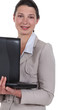 Woman carrying her laptop