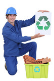 Builder holding recycle sign