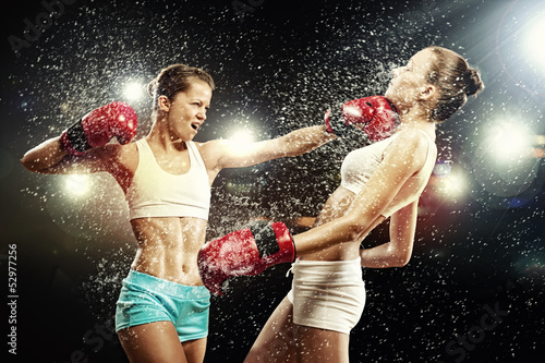 Two pretty women boxing