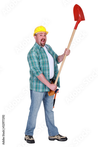 Happy man holding shovel