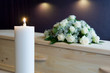 Burning candle in mortuary