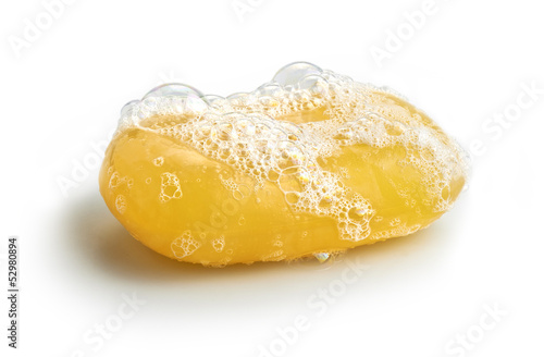 Yellow soap bubble of isolation on a white background
