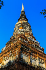 Old pagoda at temple with blue sky in Ayutthaya, Thailand.