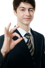 The businessman in business suit shows fingers ??
