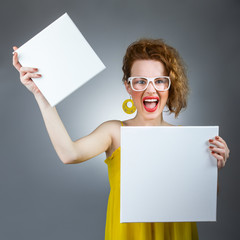 Funny woman holding blank white board