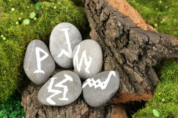 Fortune telling  with symbols on stone close up