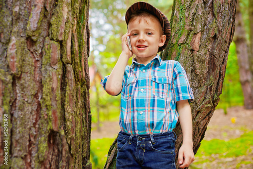 Young kid talking on mobile phone