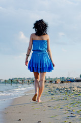 Barefoot woman walking on a beach
