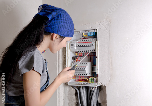 Woman looking at an open electrical box