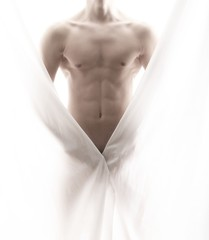 front of a partly nude male body