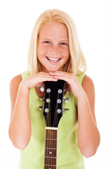 young preteen guitarist laughing
