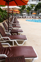 Beach chairs and swimming pool