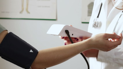 Female doctor measure blood pressure, close up