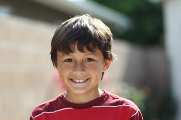 Young smiling boy outside - shallow depth of field