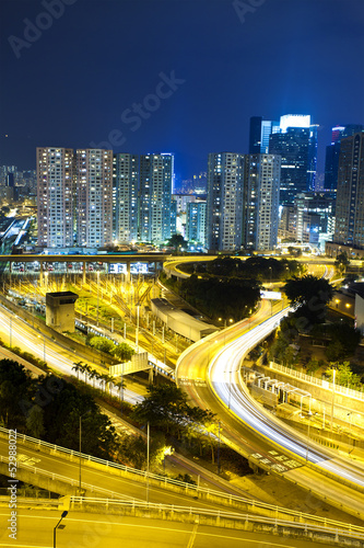 Office buildings and highway in city at night