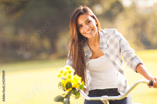woman with flowers riding a bicycle