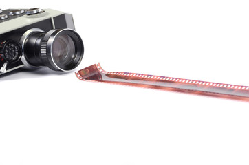Old camera and film strip isolated