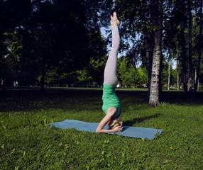 cute blonde girl making yoga outside